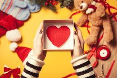Woman wrapping a heart shape toy Stock Photos