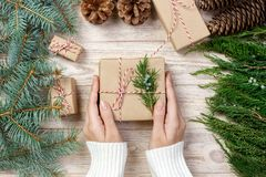Woman wrapping modern Christmas gifts presents at home.  stock images