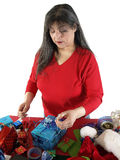 Woman Wrapping Present Stock Images