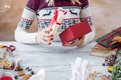 Woman wrapping present box Stock Photo