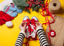 Woman wrapping red gumshoes Stock Image