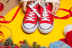 Woman wrapping red gumshoes Royalty Free Stock Photo
