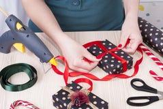 Woman wraps gift Stock Photo