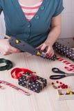Woman wraps gift Stock Image