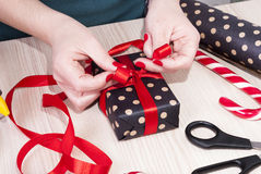 Woman wraps gift Royalty Free Stock Photography