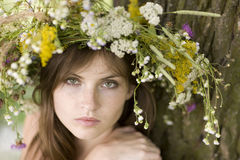 Woman with wreath. Beauty woman with wreath near tree Royalty Free Stock Photo