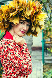 Woman with wreath of autumn maple leaves on the head Stock Photography