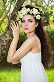 Woman with wreath of buttercup near tree Royalty Free Stock Photography