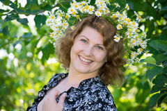 Woman with a wreath of daisies on her head Stock Images