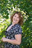 Woman with a wreath of daisies on her head Stock Photography