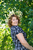 Woman with a wreath of daisies on her head Royalty Free Stock Photos