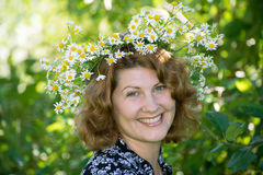 Woman with a wreath of daisies on her head Stock Photos