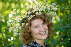 Woman with a wreath of daisies on her head Stock Photo