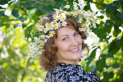 Woman with a wreath of daisies on her head Royalty Free Stock Photography