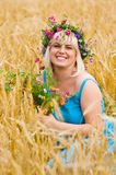 Woman in wreath of flowers Royalty Free Stock Photos