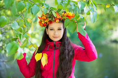 Woman with wreath on her head. Autumn, fall Stock Images