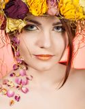 Woman with wreath on her head Stock Image