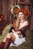 Woman with wreath of red leaves in rustic style Royalty Free Stock Photos