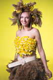 Woman in a wreath of reeds and daffodils royalty free stock photos