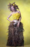 Woman in a wreath of reeds and daffodils stock image
