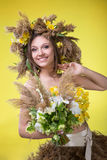 Woman in a wreath of reeds and daffodils stock images