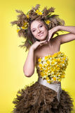Woman in a wreath of reeds and daffodils stock photos