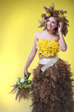 Woman in a wreath of reeds and daffodils royalty free stock images