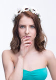 Woman with wreath touching her chin Stock Images