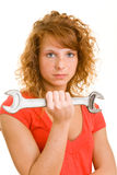 Woman with wrench Stock Image