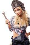 Woman and wrench Royalty Free Stock Photos