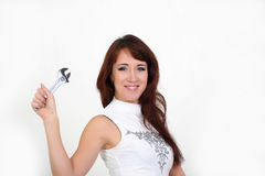 Woman with a wrench Stock Image