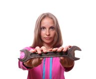 Woman with wrench, isolated Royalty Free Stock Images