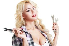 Woman with wrenches Royalty Free Stock Photo
