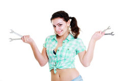 Woman with wrenchs Stock Photo