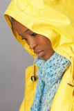 Woman Wring Yellow Raincoat In Studioea Stock Photo