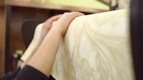 Woman is wringing a roll of wallpaper, close-up. stock video footage