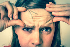 Woman with wrinkles on forehead - retro style Royalty Free Stock Image