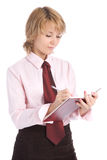 Woman wriring in to organizer Stock Photography