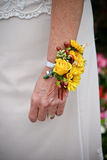 Woman wrist corsage. Wedding flowers yellow hand arm Royalty Free Stock Photography