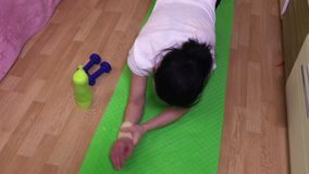 Woman with wrist injury try to do push ups. Stock footage video stock footage