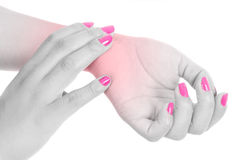 Woman with wrist pain and pink nails Stock Images