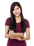 Woman write on the board Stock Images