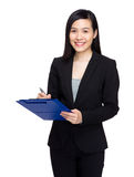 Woman write on clipboard Royalty Free Stock Image