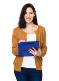 Woman write on clipboard Stock Photos