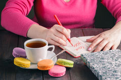 Woman write letter i love you while drinking coffee Royalty Free Stock Photos