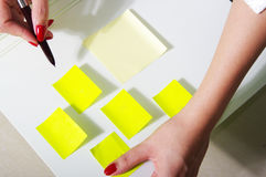 Woman write on note reminder Stock Photo
