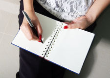 Woman write on notebook Stock Photos