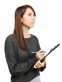 Woman write report Stock Photos