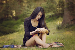 Woman writer is inspired by nature. Beautiful woman writer is inspired by nature Stock Images