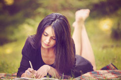 Woman writer is inspired by nature Royalty Free Stock Photo